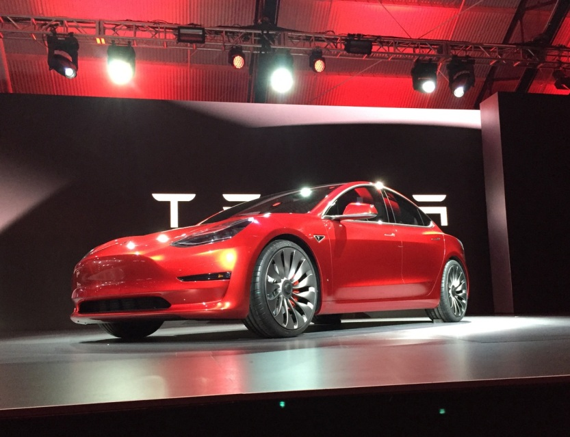Tesla-Logo-Model-3-Red-Side.jpg
